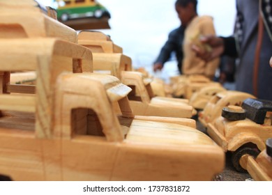 Picture of Peugeot 404 car toys, made by wood, Madagascar