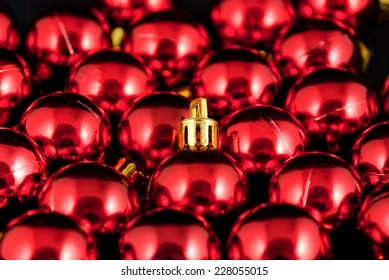 picture of a pile of red christmas balls