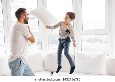 Picture of Playful young father having fun with his son and enjoy at home