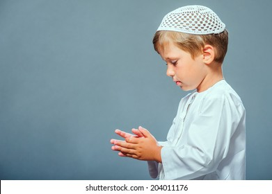 Picture of praying Middle eastern boy.