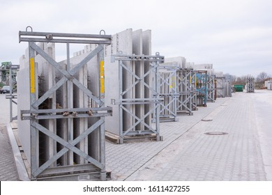 Picture of precast concrete walls ready for shipping in transport racks in panel stock