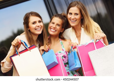 Picture presenting group of girlfriends shopping in the city