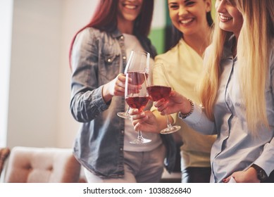 Picture presenting happy group of friends with red wine.