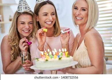 Picture presenting happy group of friends celebrating birthday