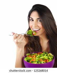 Picture of pretty woman eating green salad, closeup portrait of brunette female holding bowl with fresh vegetables isolated on white background, healthy lifestyle, organic nutrition, dieting concept