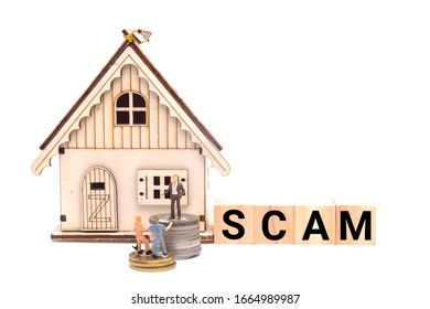A picture of property scam concept using wooden block and miniature. Many people been deceived in property game that lead to scam and high housing loan.