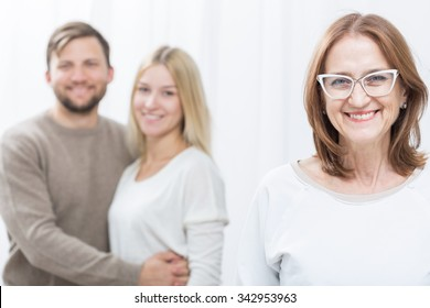 Picture of psychologist and happy married couple after therapy