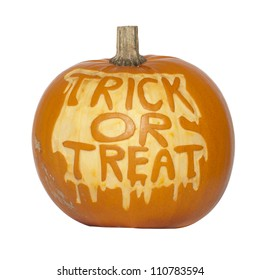 Picture of a pumpkin, with Trick Or Treat cut in the surface Isolated, white background