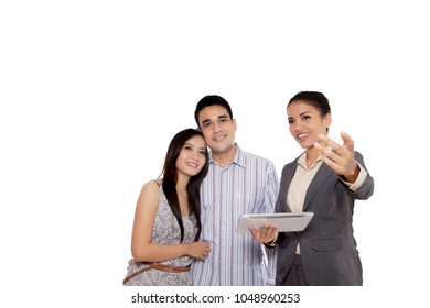 Picture of real estate agent showing something for sell to a young couple, isolated on white background