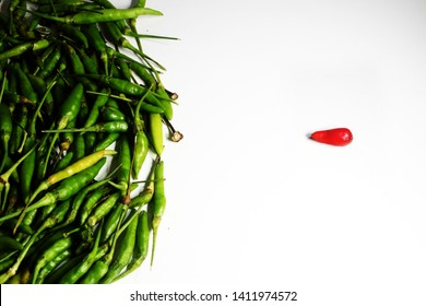 """A picture of red """"cili padi kampung"""" isolated from other chillies. """"Cili padi kampung"""" is the most spicy chilli in the world."""