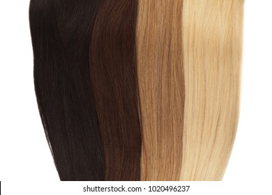 Picture of remy woman's hair extensions in different colors isolated on white