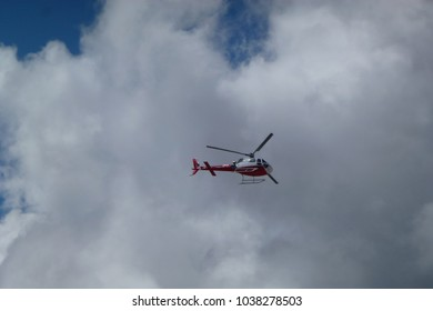 Picture of a rescue helicopter over big clouds, Gorak Shep, Everest Base Camp trek, Nepal
