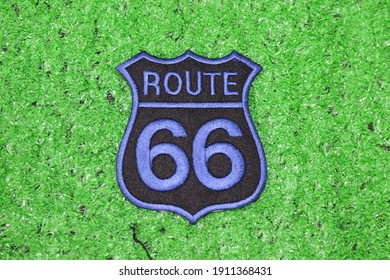 PICTURE OF ROUTE 66 SIMBOL ON GREEN BACKGROUND
