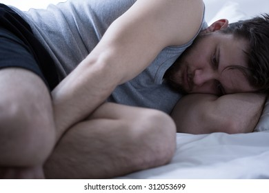 Picture of sad and exhausted man with insomnia