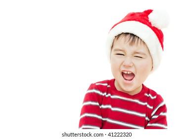 picture of screaming Christmas kid in Santa's cap