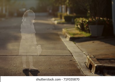 picture of see through shadow of little girl and her doll on the road in evening time.Girl was disappeared,shadow still remaining.Concept of missing and exploited children,lose child