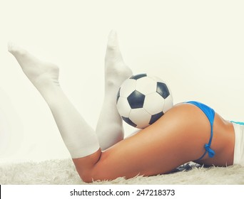 Picture of sexy woman's butt and legs on a fur with a ball