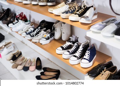 Picture of shelves with sport shoes in the shoes shop
