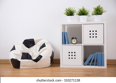 Picture of shelving unit and new sit in teenager room