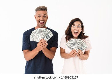 Picture of shocked screaming adult loving couple isolated over white wall background holding money.