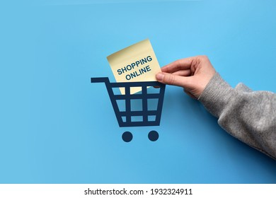A picture of a shopping cart and an inscription: shopping online. Online shopping Symbol