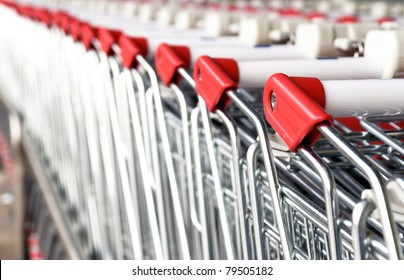 Picture of the shopping carts collected in line.