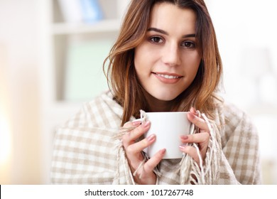 Picture showing adult woman covered with blanket having flu