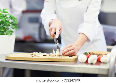 Picture showing busy chef at work in the restaurant kitchen