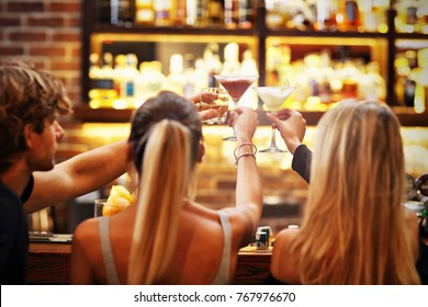 Picture showing group of friends enjoying drink in bar