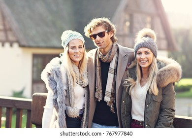 Picture showing group of friends walking together in winter