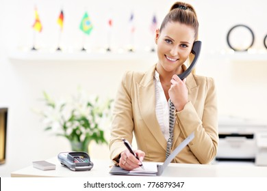 Picture showing happy receptionist working in hotel
