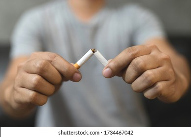 The picture shows a broken cigarette. Concept to stop smoking