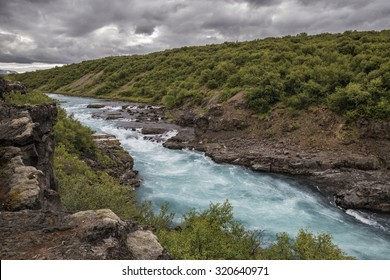 The picture shows the river Hvita in Iceland.