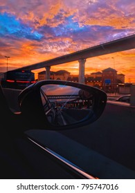 Picture of side mirror with heavy traffic during sunset