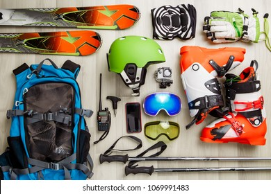 Picture of skier objects on wooden background.