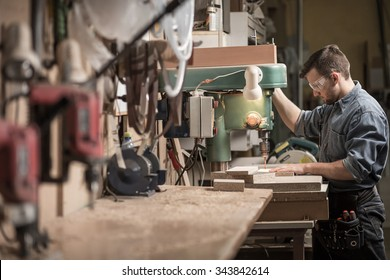 Picture of skilled carpenter using new technology at work