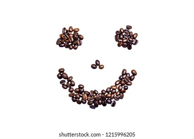 Picture of a smiley face made of coffee beans on white background
