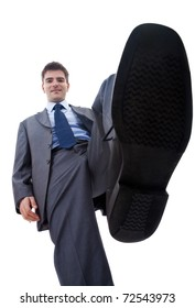 picture of a smiling business man steping on something, over white