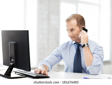picture of smiling businessman with smartphone in office