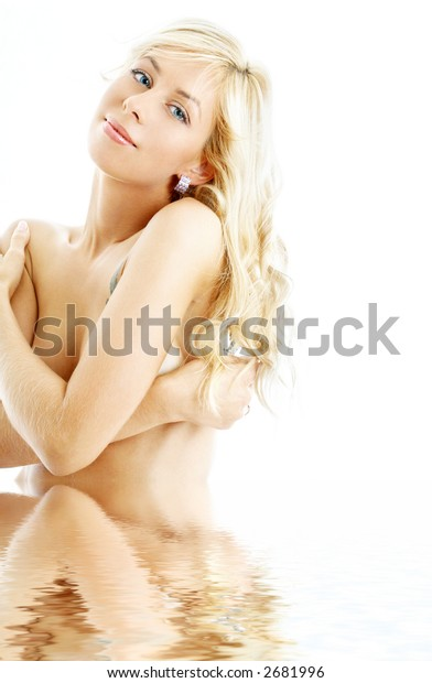 picture of smiling topless blond standing in water