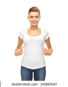 picture of smiling woman pointing at blank white t-shirt