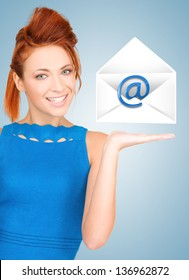 picture of smiling woman showing virtual envelope