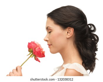 picture of smiling woman smelling flower