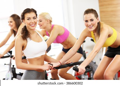 Picture of sporty group of women on cycling class