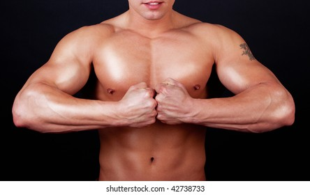 Picture of strong man with tattoo