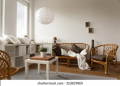 Picture of stylish wicker loveseat and two chairs