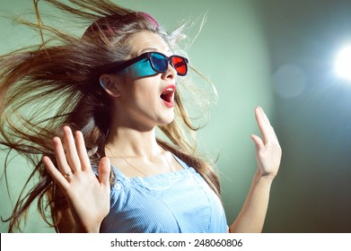 Picture of surprised young pretty lady in 3d glasses looking amazed