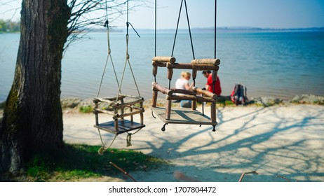 A picture of a swing infront of the Chiemsee