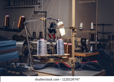 Picture of a tailor's desktop at the sewing workshop.