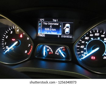 A picture was taken from a modern rental car dashboard to document the mileage for preventive legal purposes in our litigation happy society. The modest design is straightforward with no clutter.
